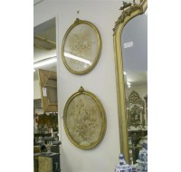 Two oval gilt frames with silk embroidery