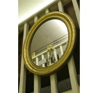 French 19th century Louis Phillippe oval gilded mirror, circa 1860