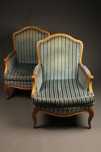 Pair of French Louis XV style bergére chairs with hand carved frame and wood pegged construction