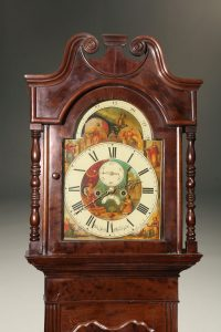 Mid 19th century English tall case clock with plum pudding mahogany case, circa 1860.