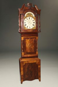 19th century English tall case clock with wonderful mahogany case and hour striking 8 day movement