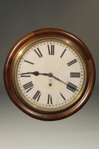 Late 19th century Ansonia gallery clock with an 8 day movement and walnut case