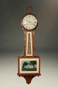 New Haven Clock Company banjo clock with reversed painted glass depicting Mt. Vernon