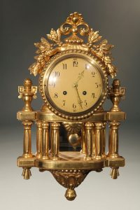 Vintage French Louis XVI style clock with gilded finish.
