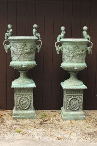 Pair of custom French garden urns with ram heads and puttis.