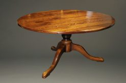 """60"""" round custom English pedestal table in cherry wood."""