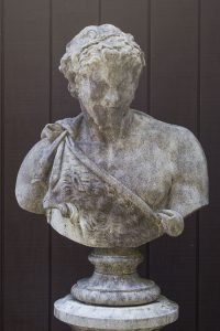English cast limestone bust of Bacchus atop a classically styled column