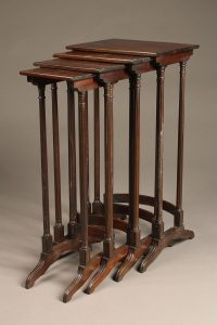 Very nice set of English nesting tables in solid mahogany
