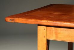 Custom French farmhouse table with stretcher made in solid cherry