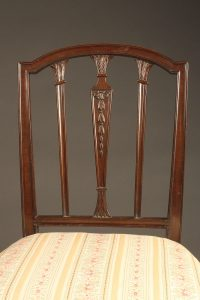 Late 19th century pair of English Hepplewhite side chairs, circa 1890.