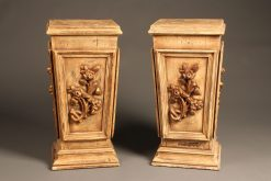 Pair of vintage wood pedestals with nicely carved details.