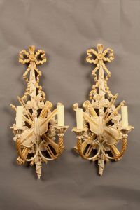 Pair of 2 arm hand carved Italian sconces with ribbon and musical instrument motif