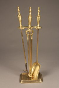 Very nice set of English brass fireplace tools with base