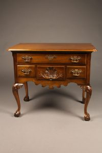 Mahogany Chippendale style low boy with ball and claw feet