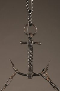 8 arm French iron chandelier in the shape of a Viking ship.