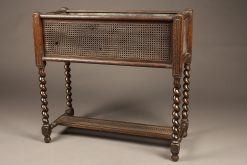 Early 20th century jardiniere in caned oak with liner and writhen legs