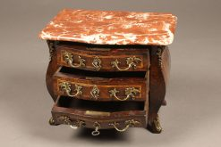Rare miniature French Louis XV style bombe chest with marble top.